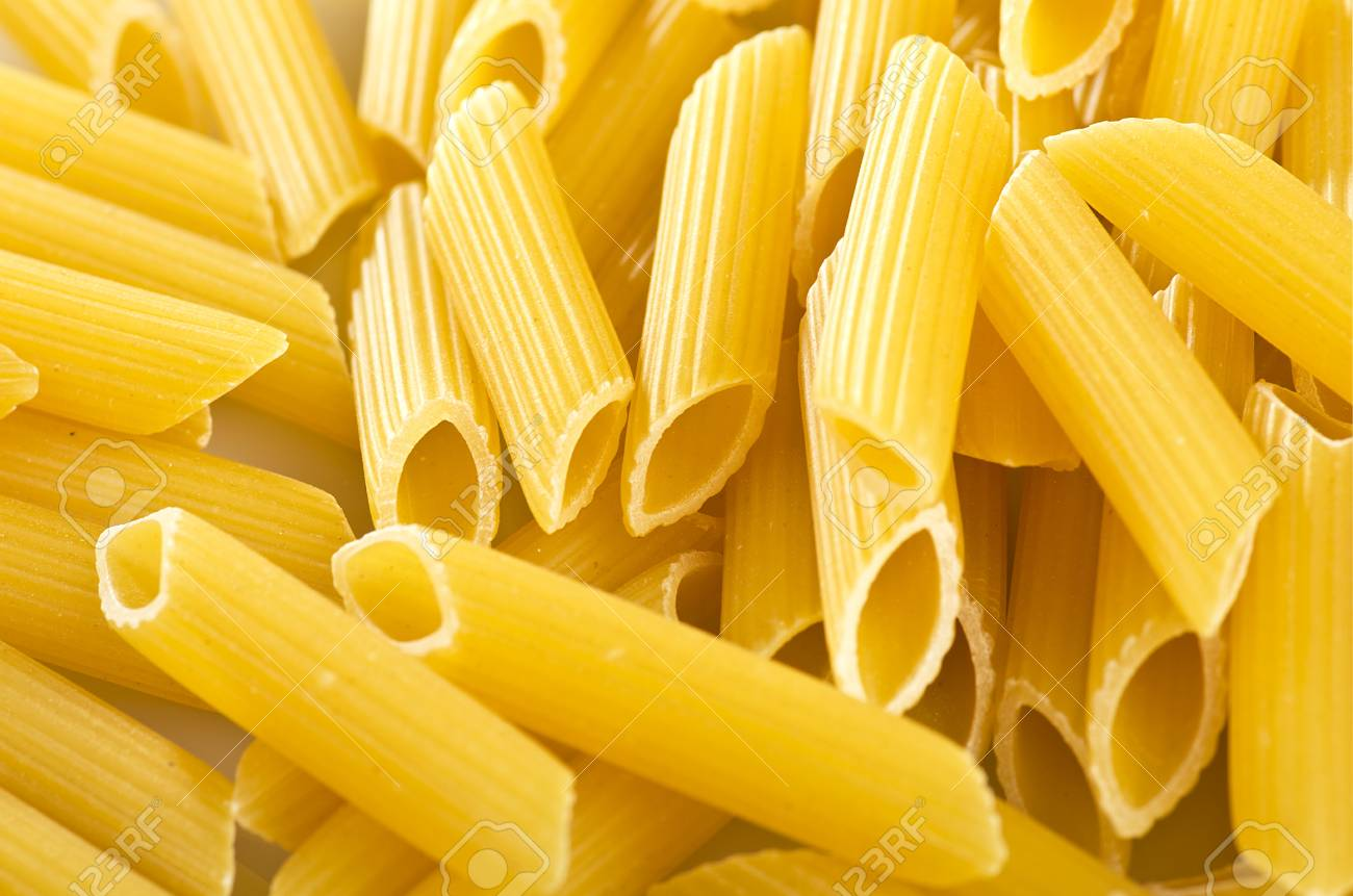italian pasta maccaroni close up on the white stock photo picture