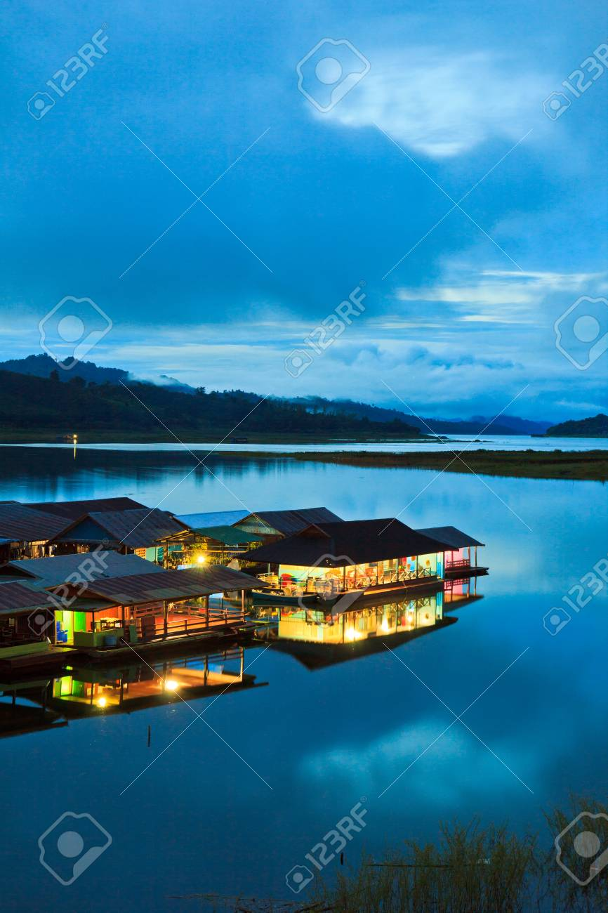 Morning light at Waterfront home and Home in the water and raft in Sangklaburi kanchanaburi Province Asai Thailand Stock Photo - 22291490
