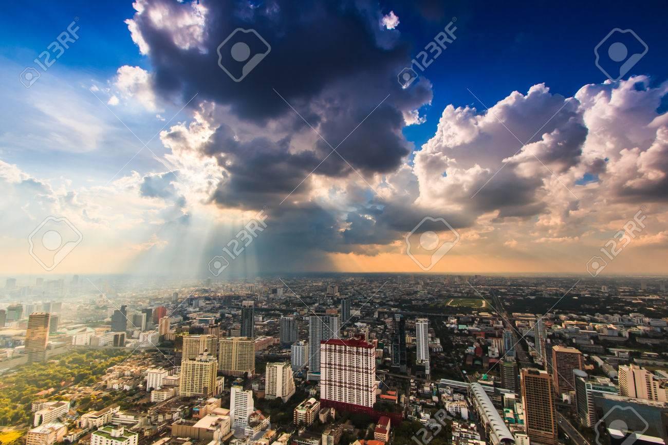Rays of light shining through dark clouds city Bangkok, Thailand Stock Photo - 24248592