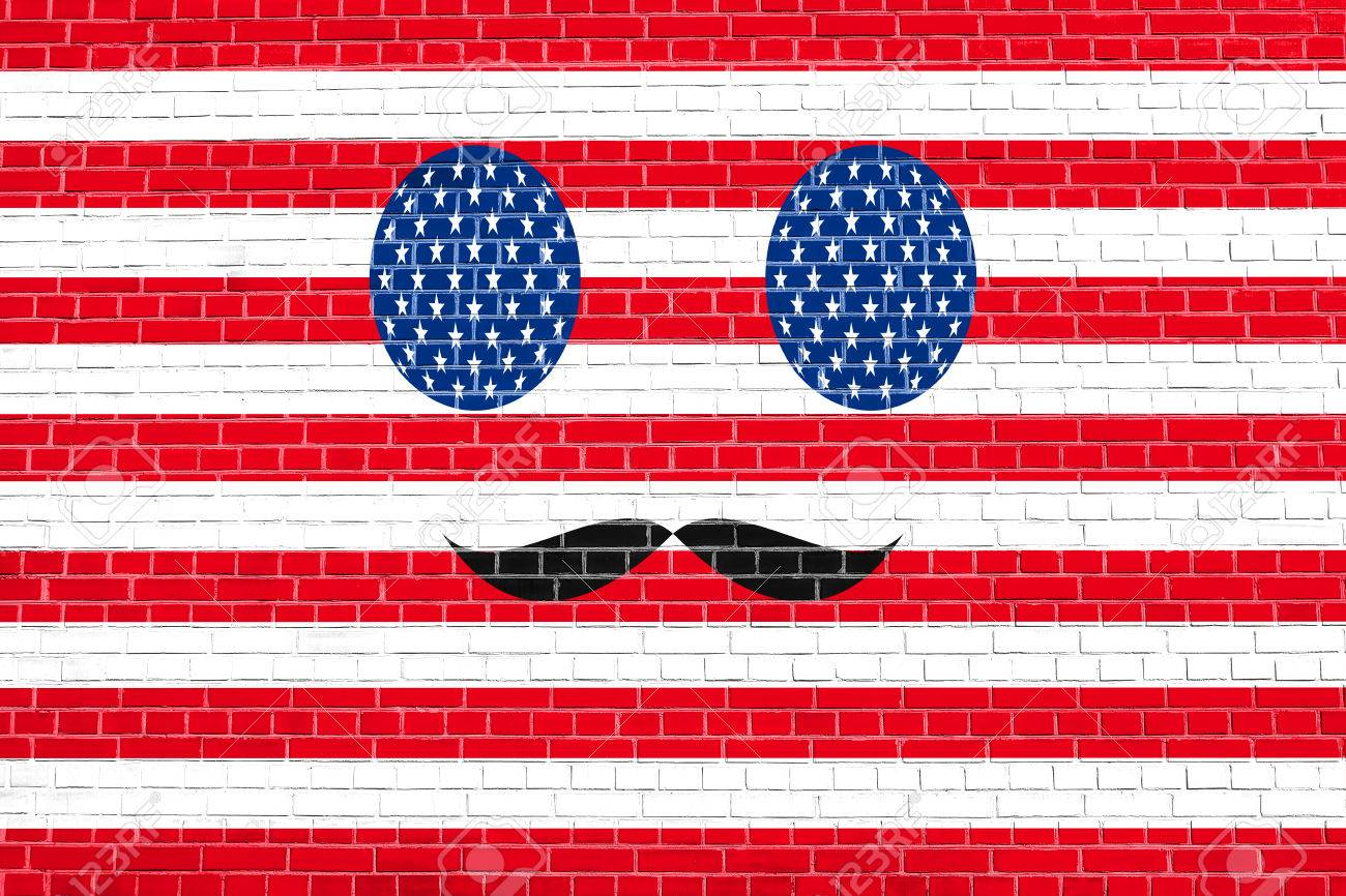 Funny Face Made Of USA Flag Simbols With Mustaches On Brick Wall Texture Background