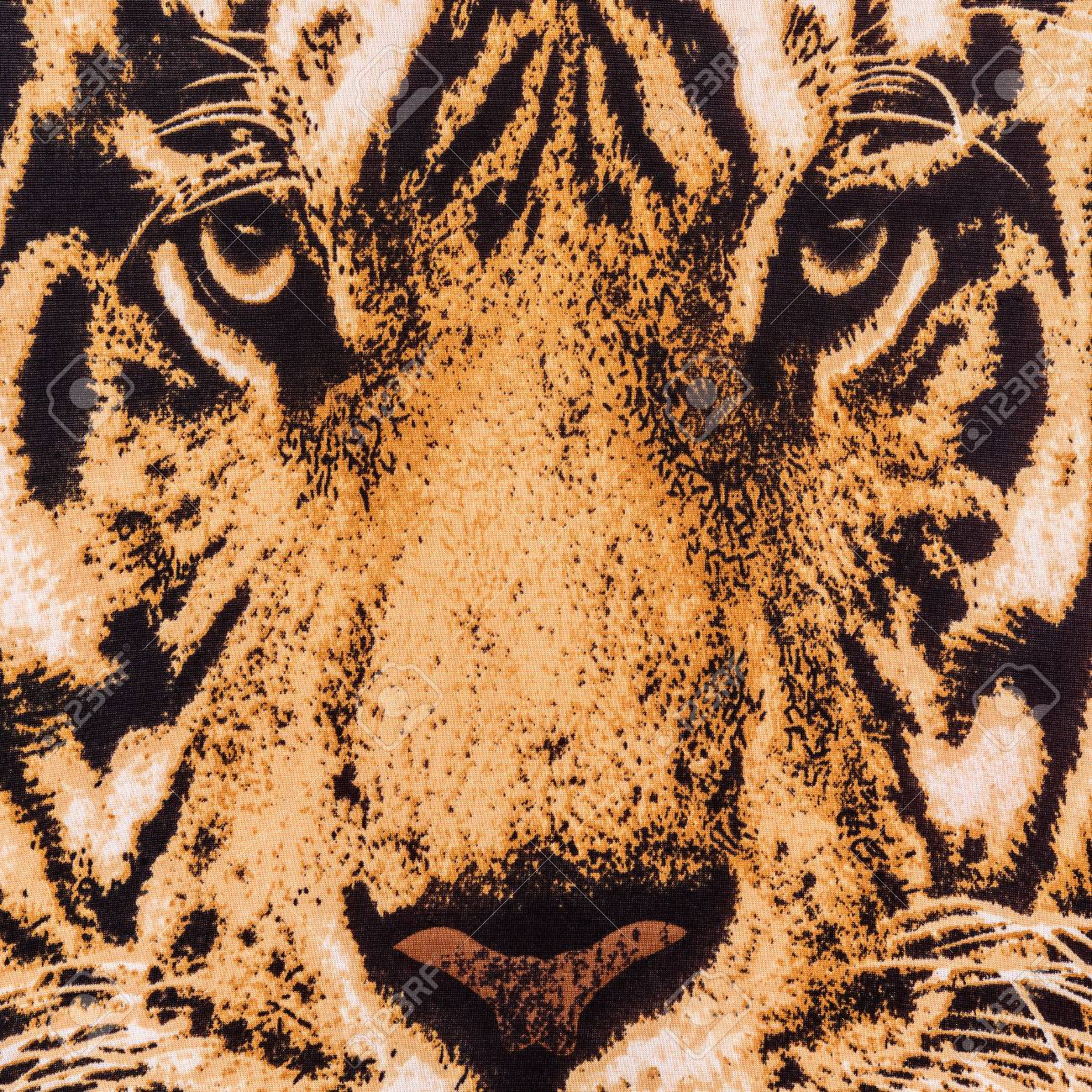 texture of print fabric striped the tiger face for background