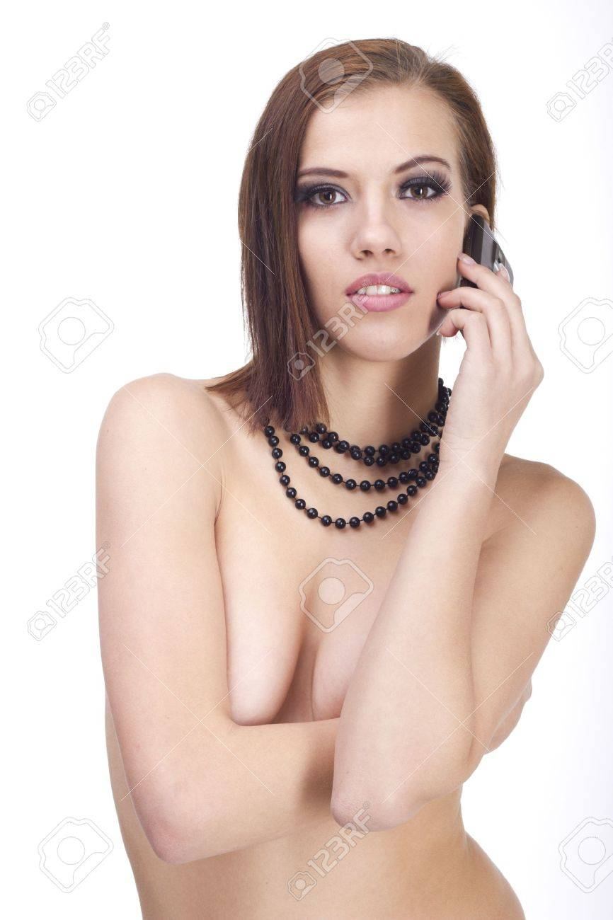 Young sexy woman with cellphone on white isolated background Stock Photo - 12758586