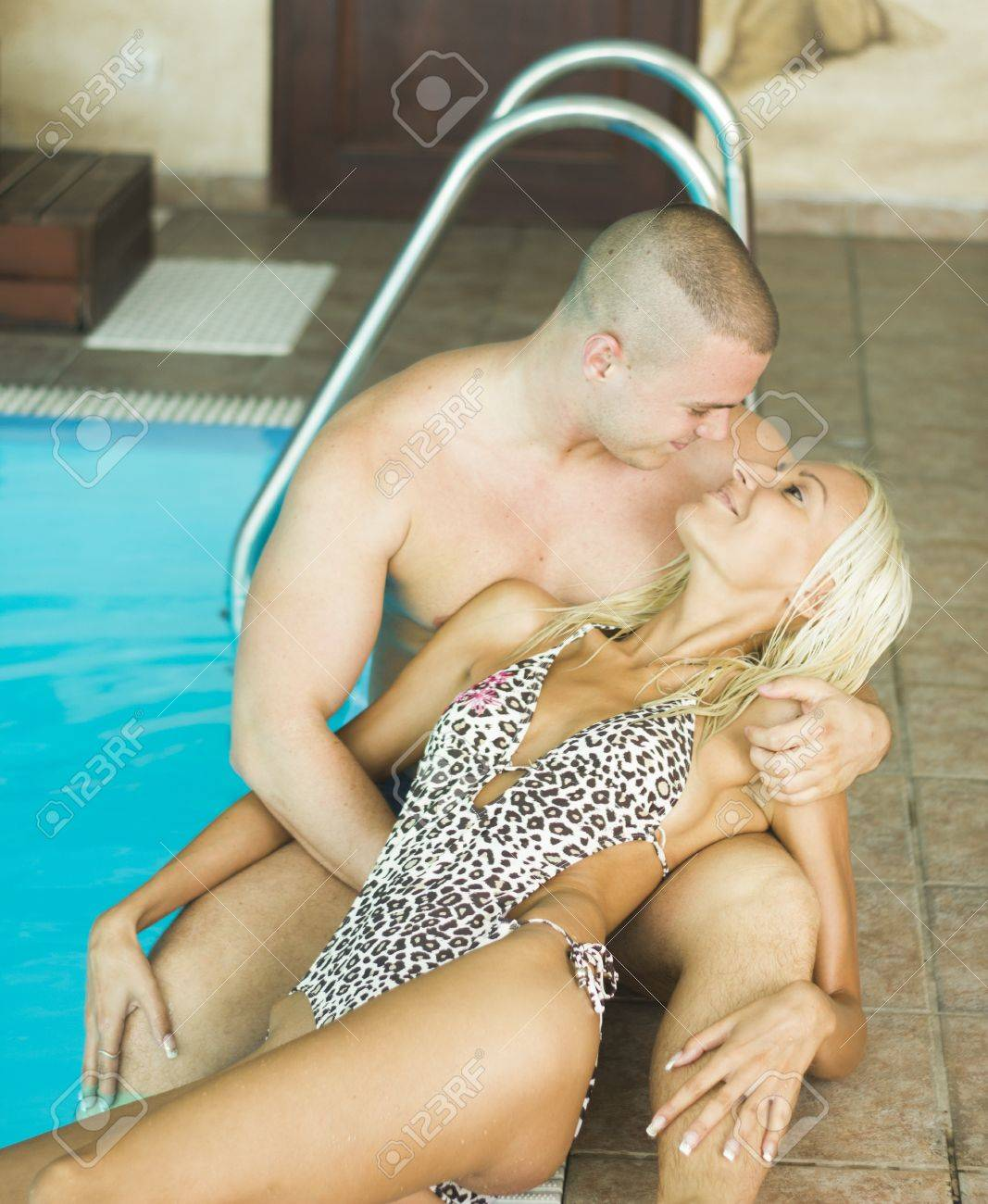 Sexy passionate heterosexual couple by a pool Stock Photo - 14531092