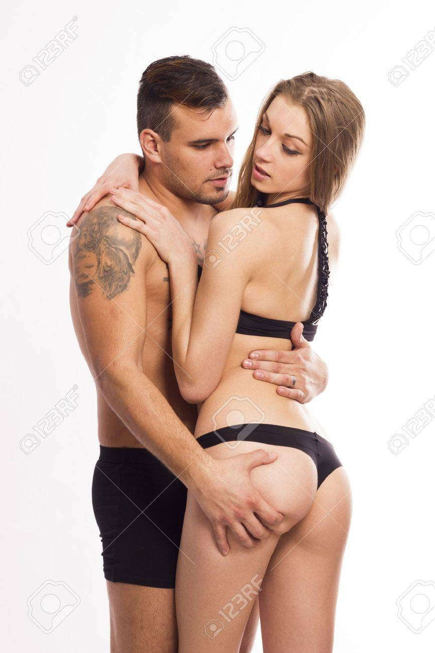 Sexy young passion couple on white isolated background Stock Photo - 17412805