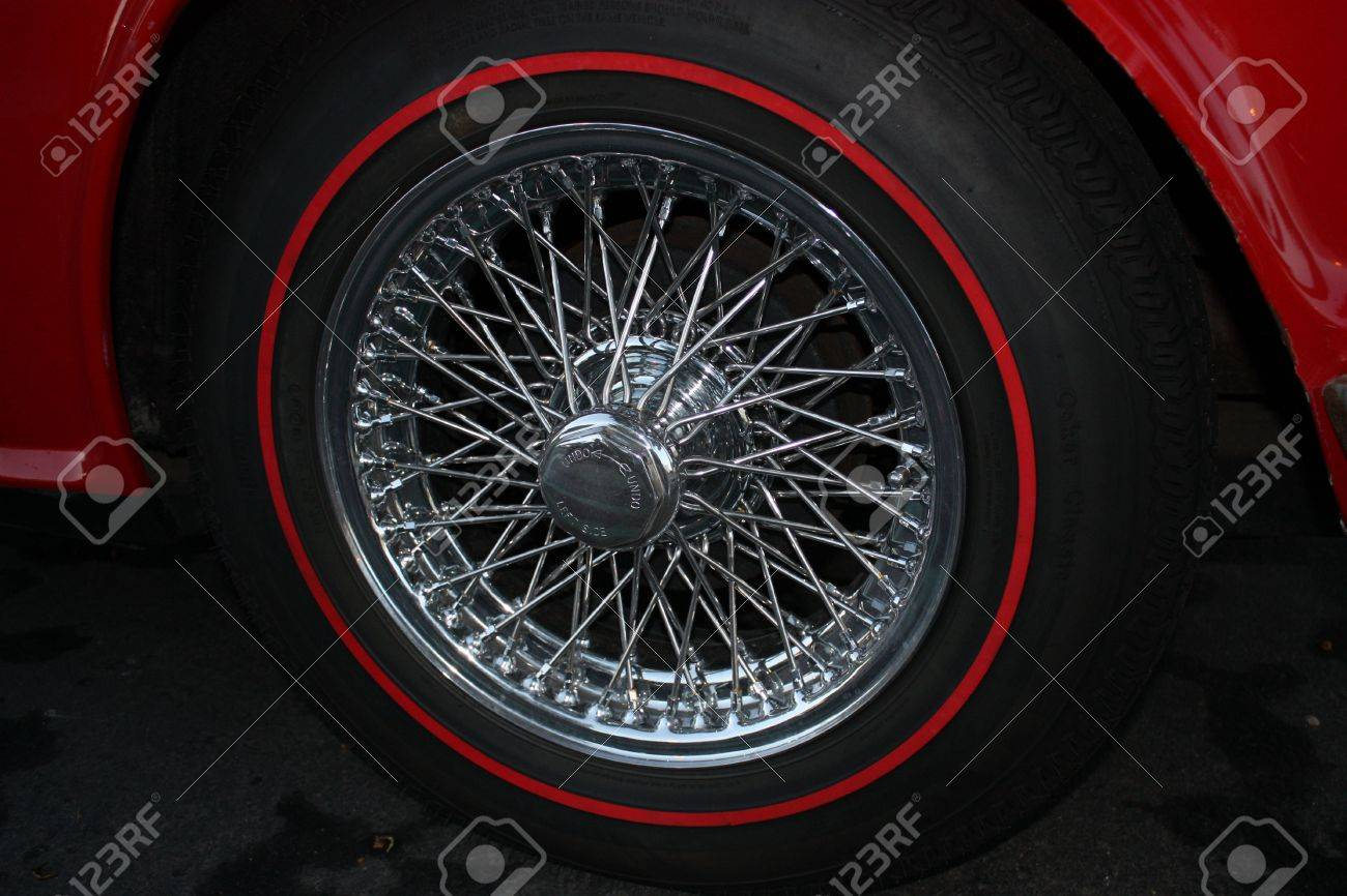 a restored vintage car wire hub caps and original red line stock photo a restored vintage car wire hub caps and original red line tires