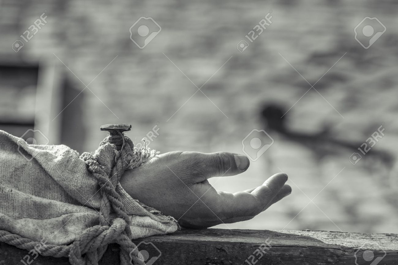 nailed hand on wooden cross crucifixion of jesus chris black