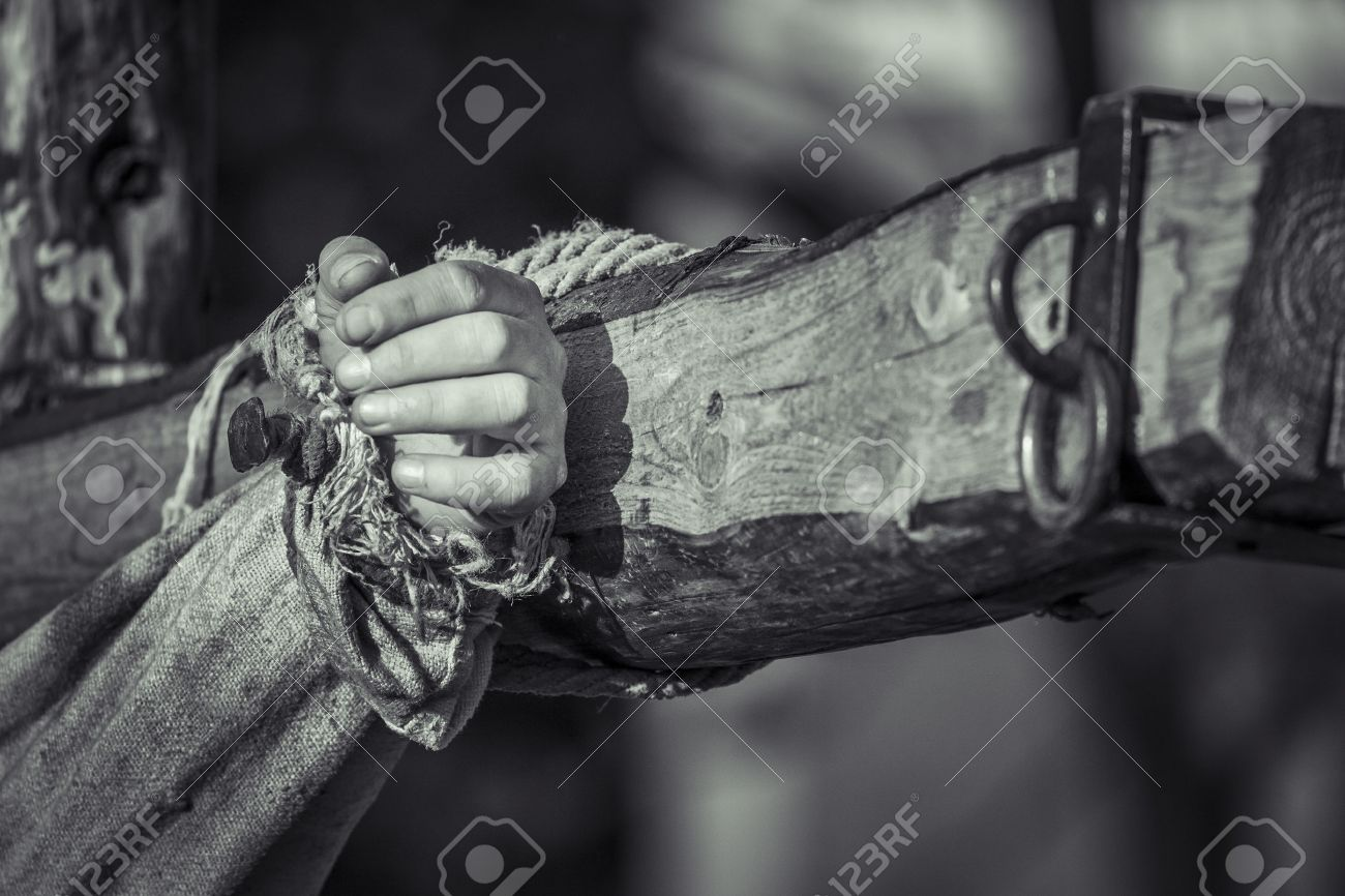 Nailed hand on wooden cross Crucifixion of Jesus Chris Black and white - 27530981