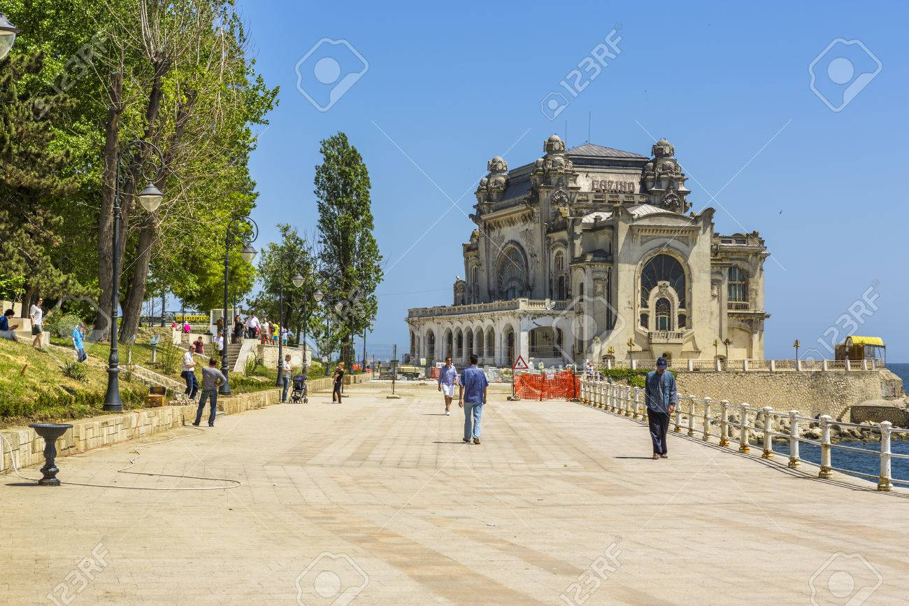 CONSTANTA, ROMANIA - MAY 25: Unidentified tourists enjoy a walk on old Casino sea wall on May 25, 2014 in Constanta, Romania. Casino is one of the most representative symbols of the city. Stock Photo - 28922801