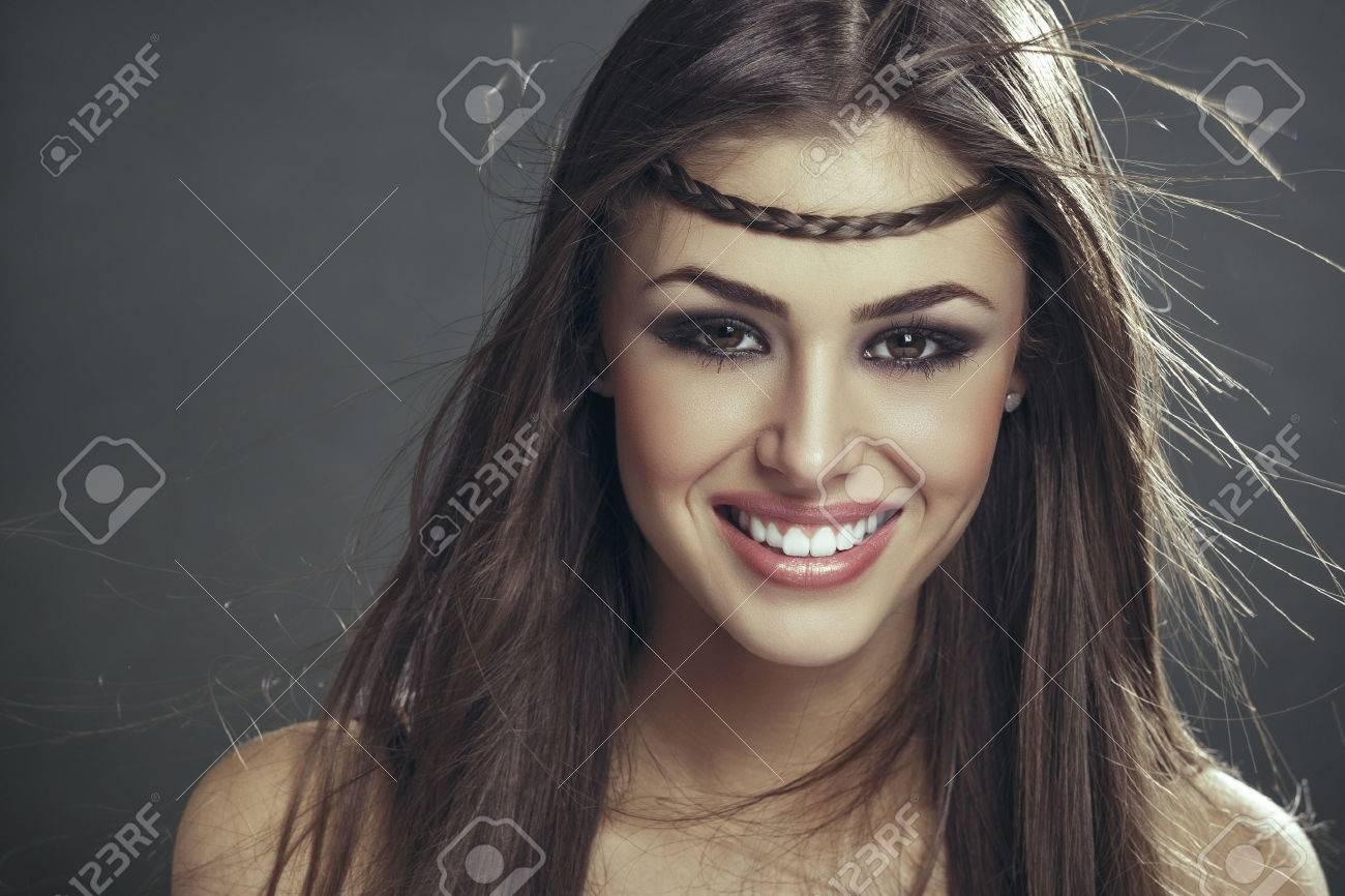 Portrait Of Beautiful Happy Smiling Woman With Braid On Her Forehead And  Brown Long Silky Hair