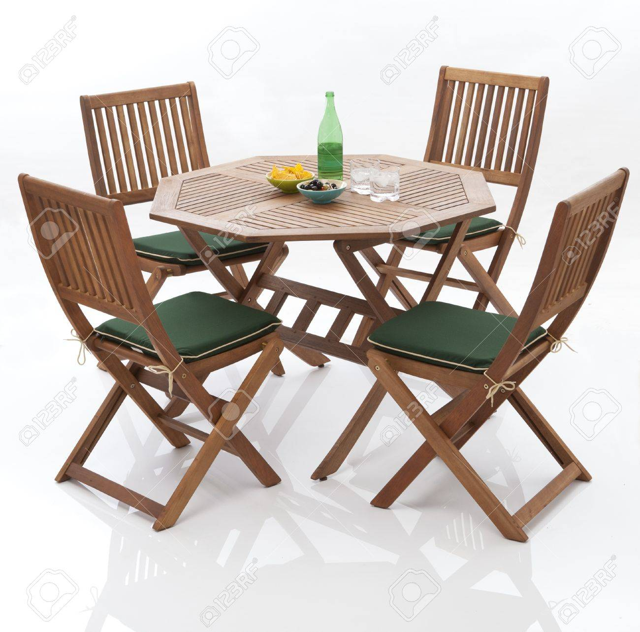 garden table and chairs on isolated white background stock photo