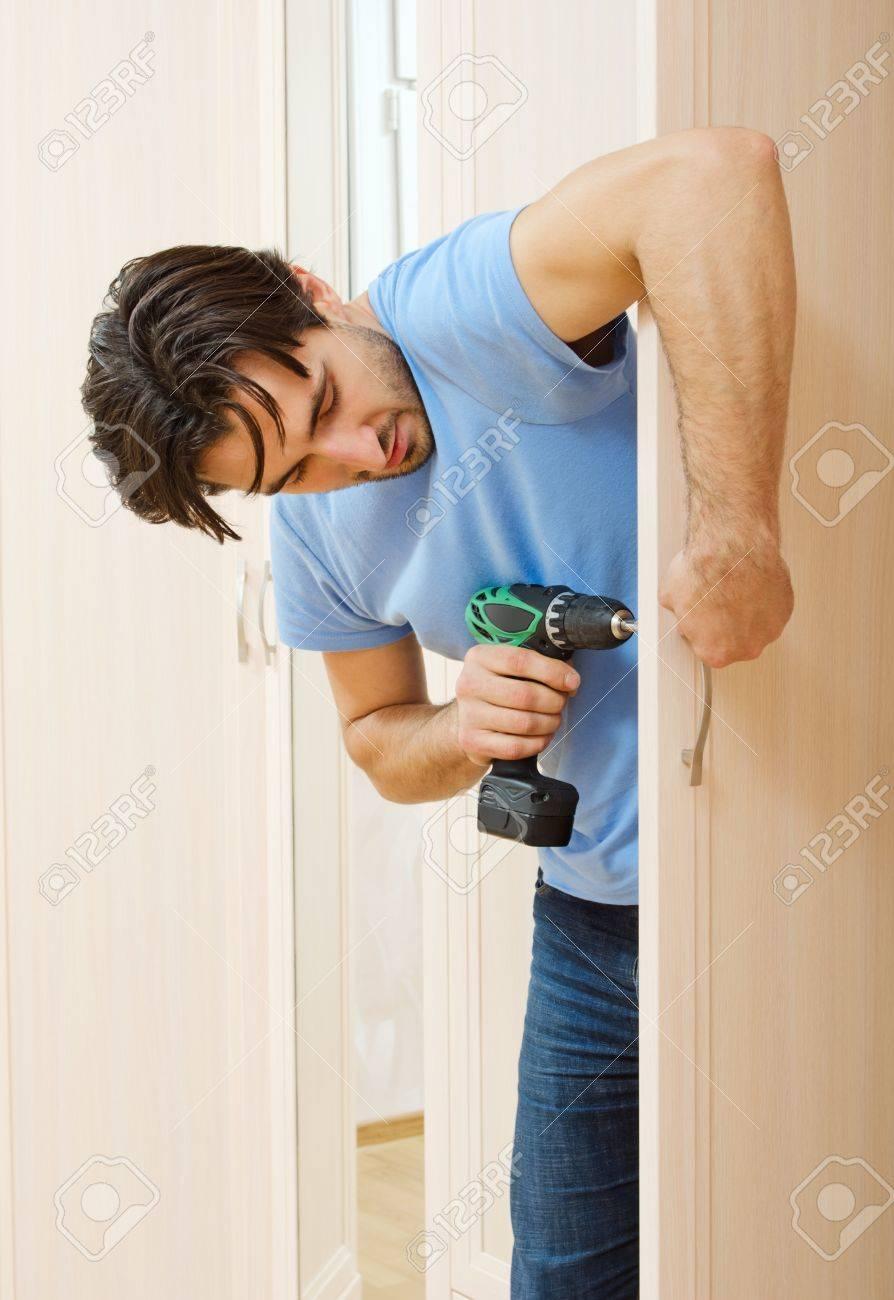 man repairing the door handle furniture Stock Photo - 16922753