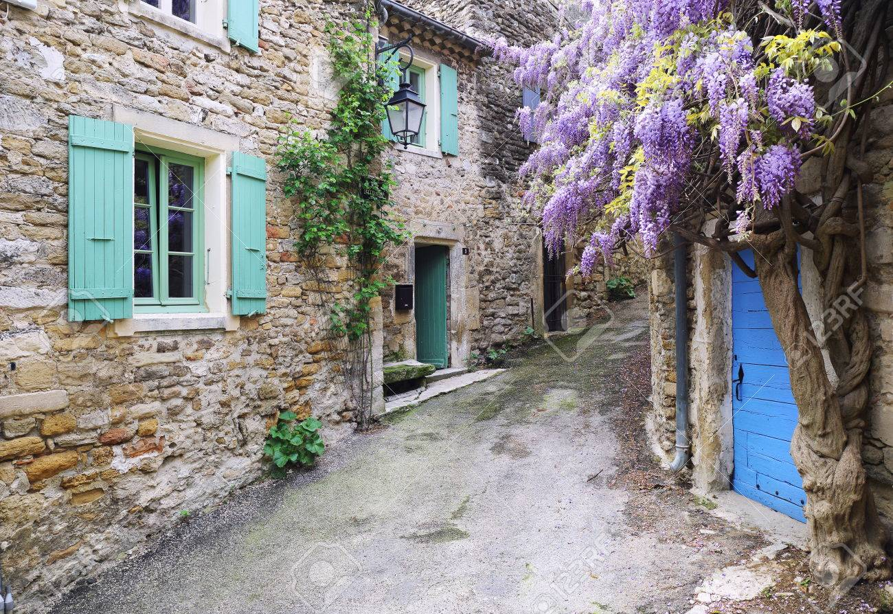 Village Of Provence Flowering Purple Wisteria Vine Stock Photo