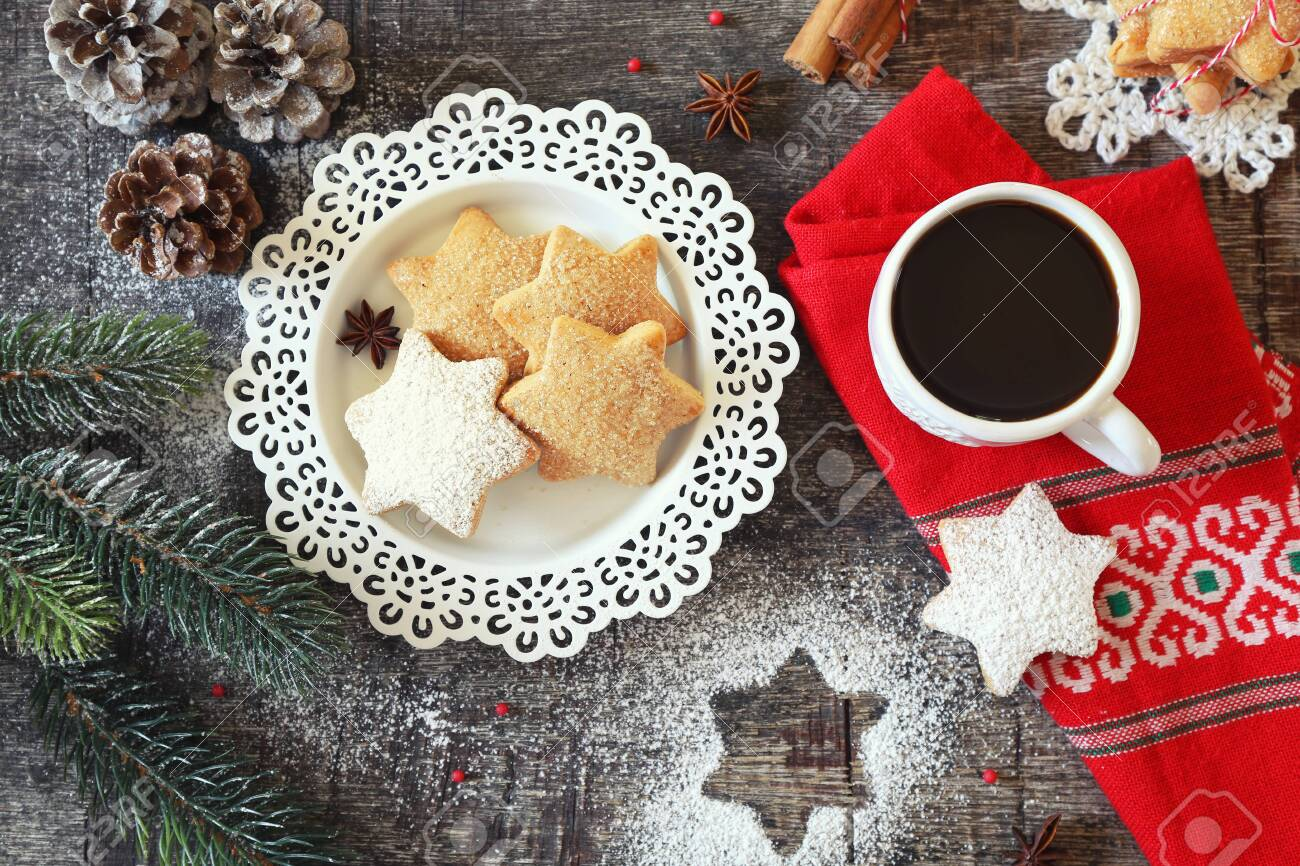 Christmas cinnamon cookies (spice-cake), cup of coffee and New Year's decoration. Top view - 138331252