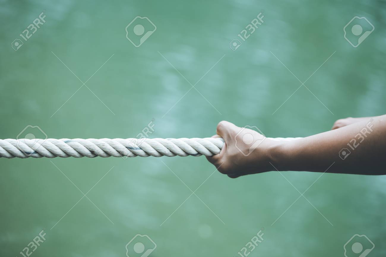 hands pulling on a rope Concept of being alone Strengthened - 110456939