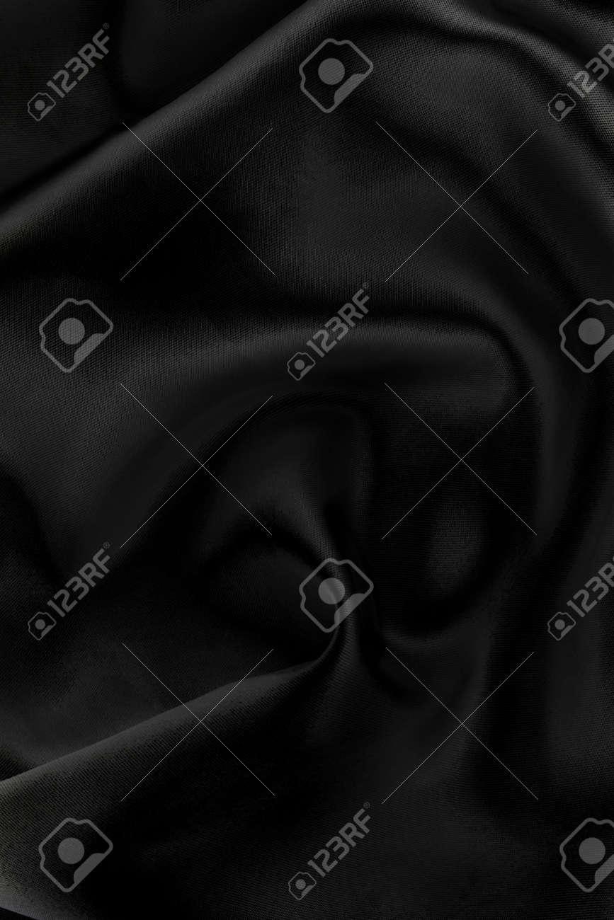 Majestic black silk textile background. Beautiful plaing of light & shadow Stock Photo - 2580509