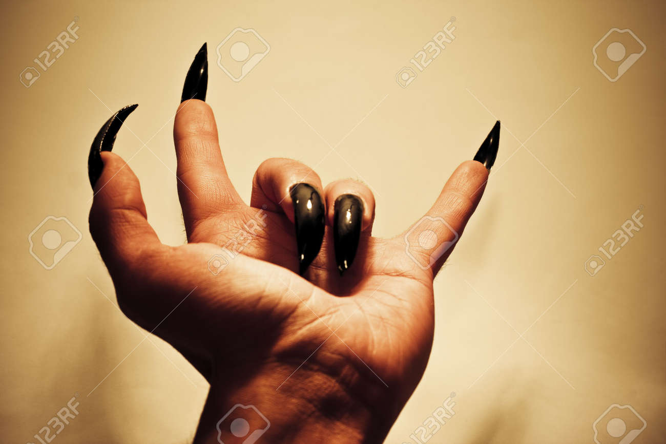 Demonic hand showing rock music gesture colored vibrant image demonic hand showing rock music gesture colored vibrant image stock photo 2673764 buycottarizona