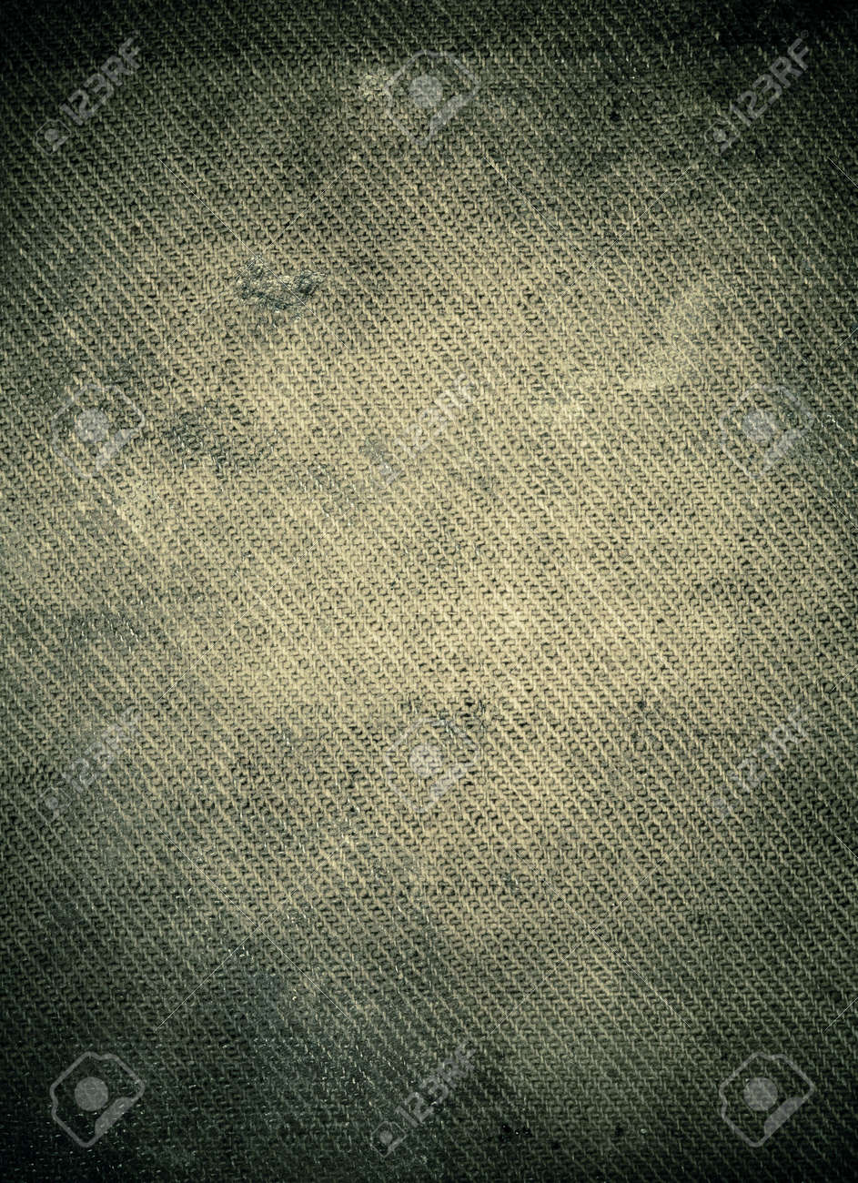 Spooky dark stained burlap background with dark borders end empty space in center Stock Photo - 6553562