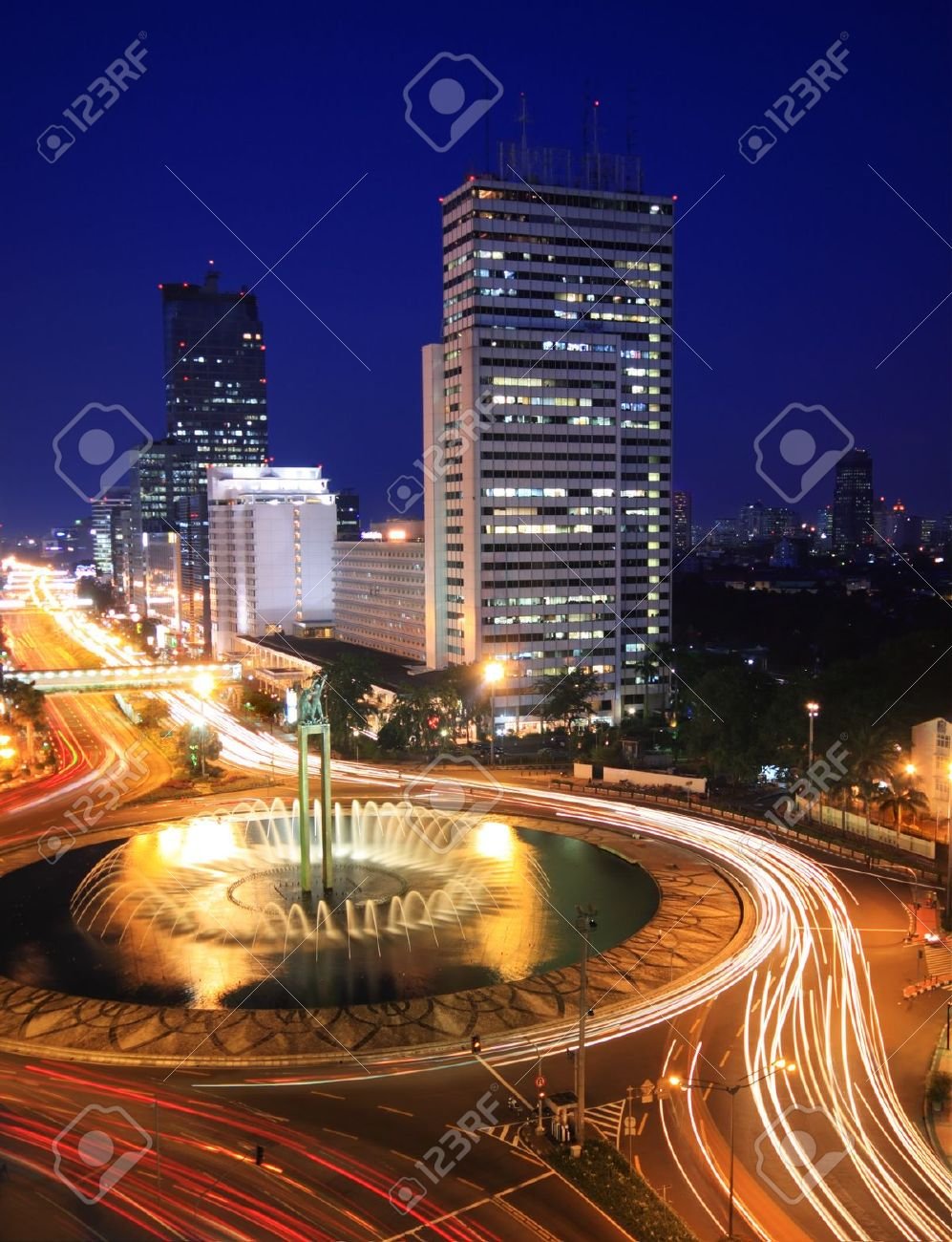 Night time view of traffic in the center of business district in Jakarta Stock Photo - 12544733