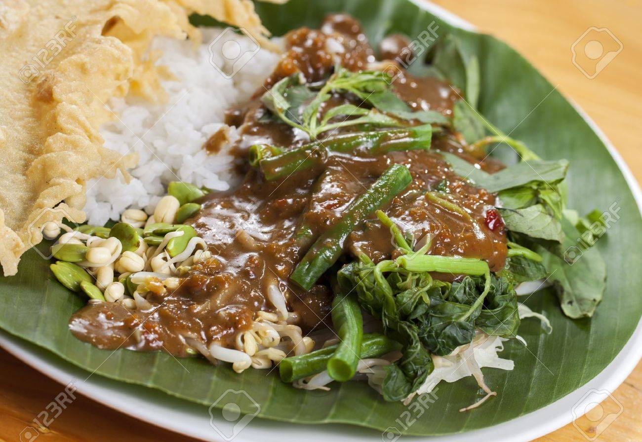 nasi pecel is a javanese rice dish served with mix vegetables