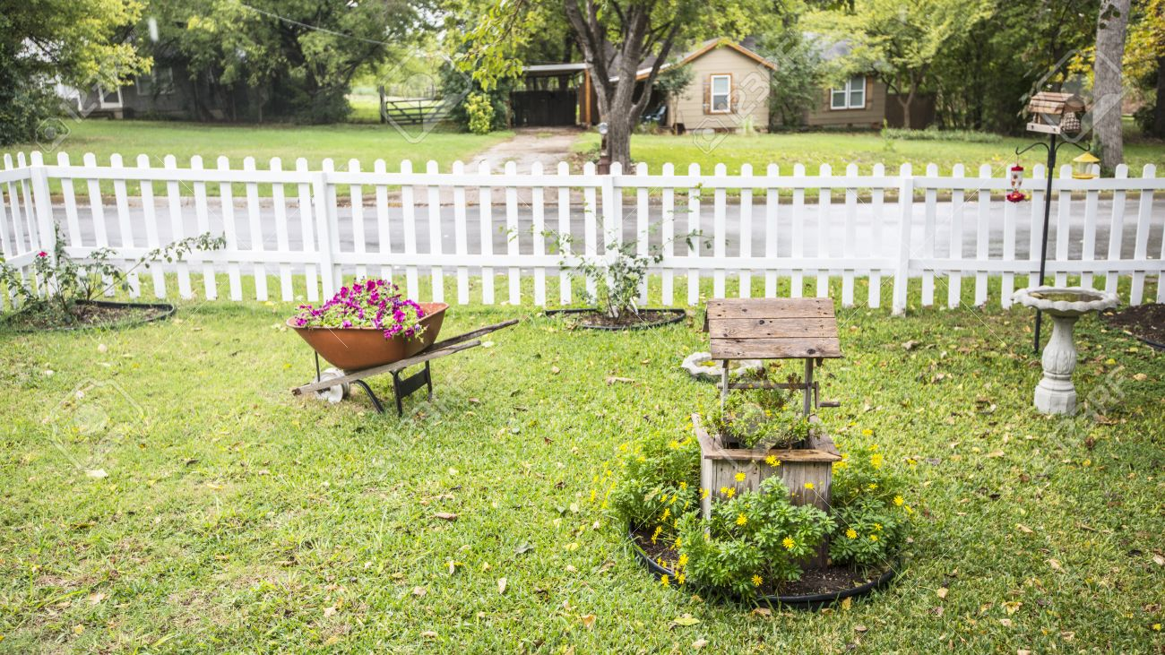 My Front Yard With Flowers In Wheel Barrow And Wishing Well Stock ...
