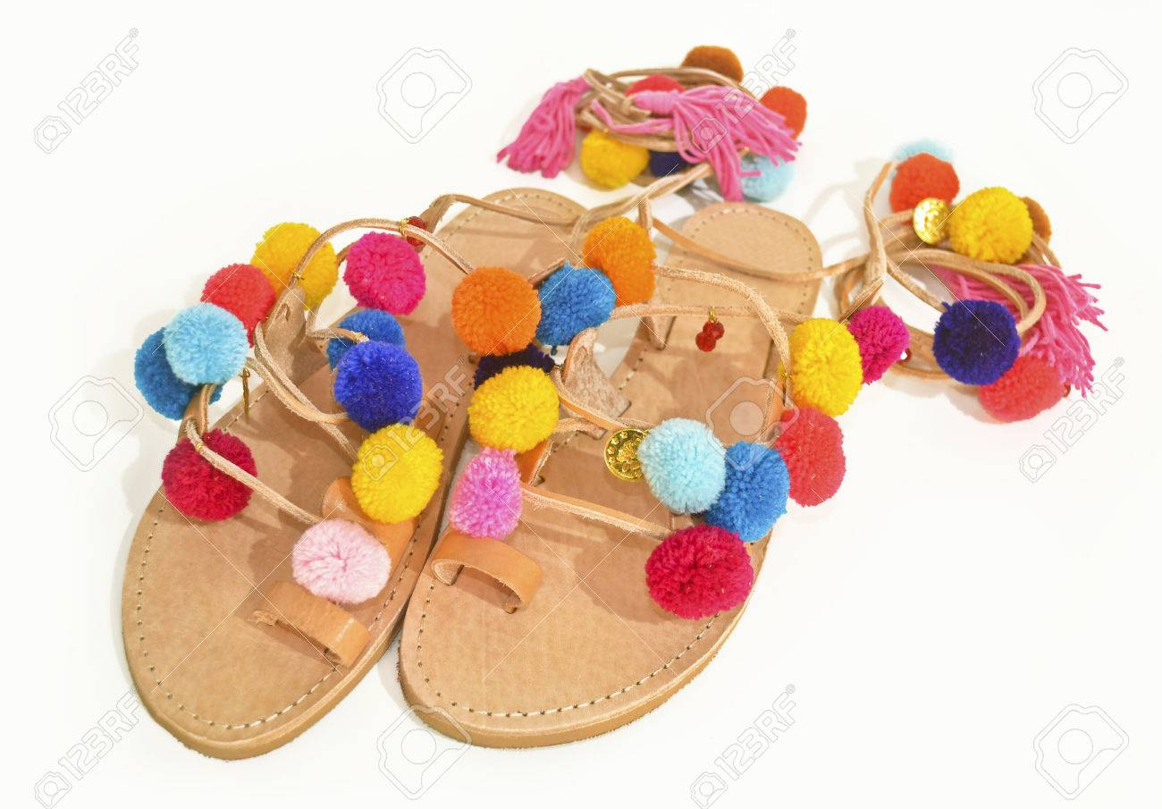 58e7c5a122a8 Stock Photo - stylish greek leather sandals with pom pom - fashion shoes  advertisement