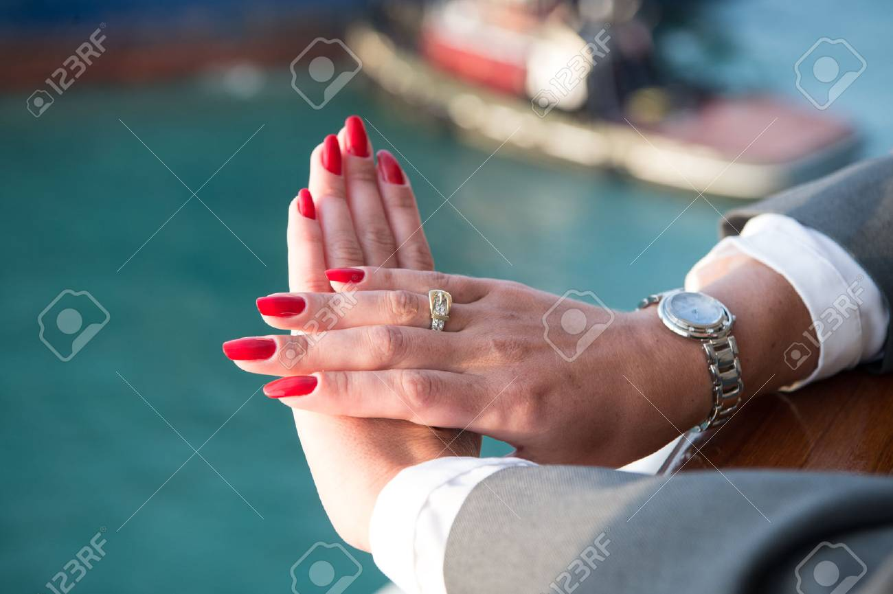 Elegant Female Hands With Red Nails Manicure With Jewels And.. Stock ...