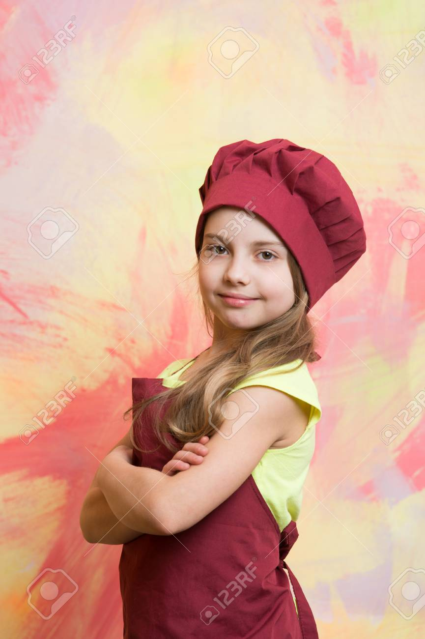 4daa3db923f small baby girl or cute child with happy face in red chef hat and cook apron