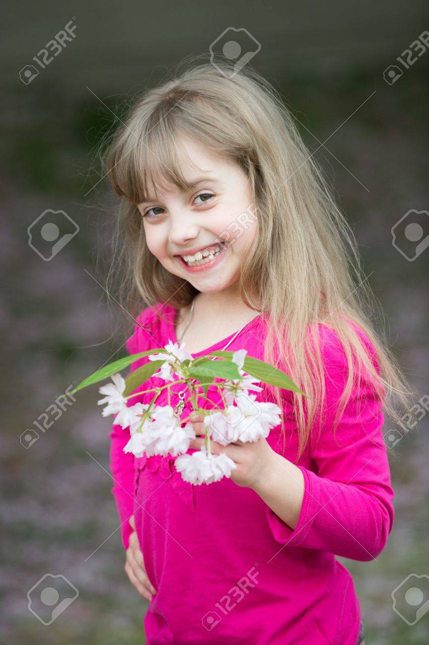 small baby girl or cute child with adorable smiling face and.. stock