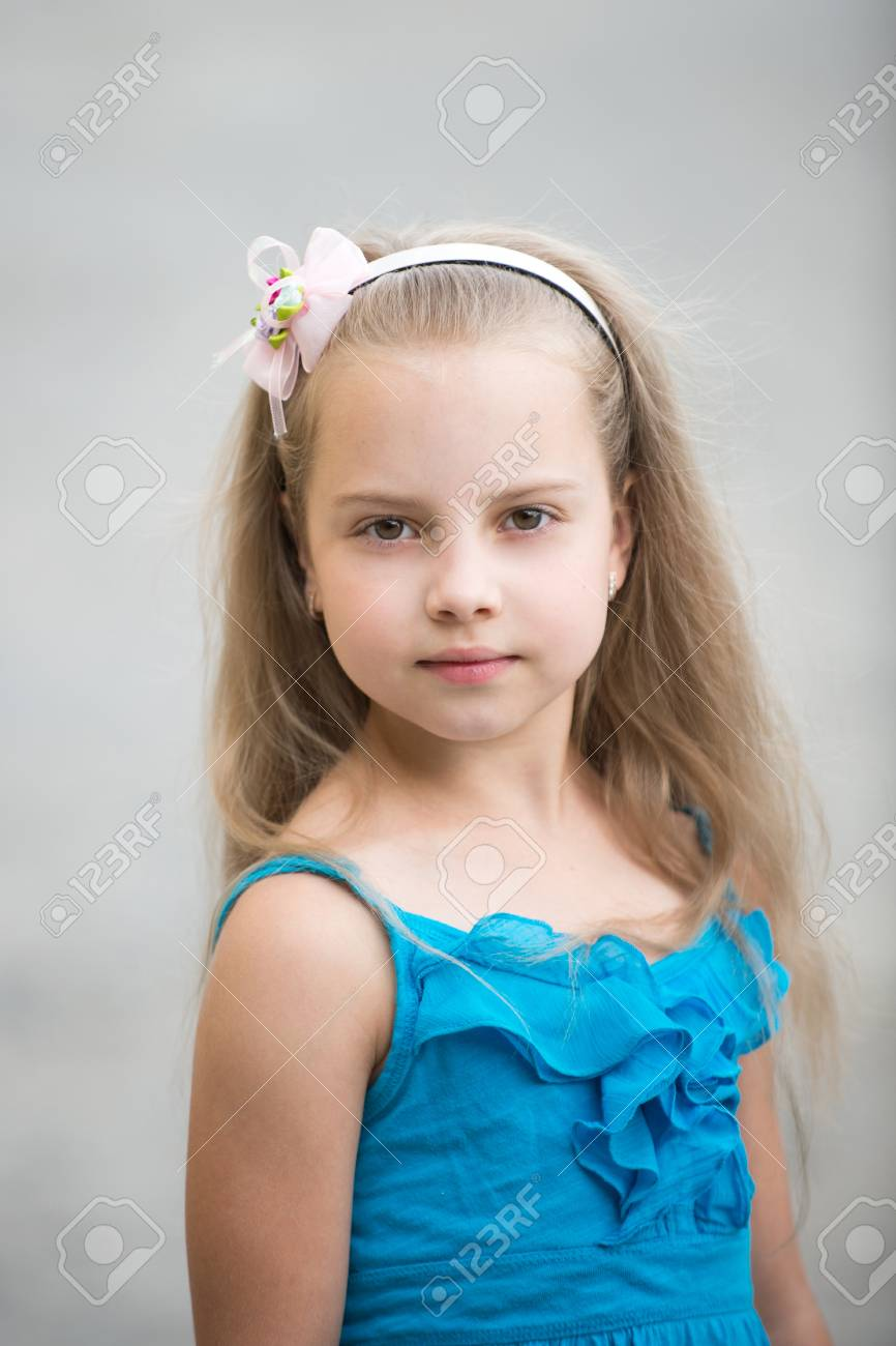 small baby girl or cute child with adorable face and bow in blonde