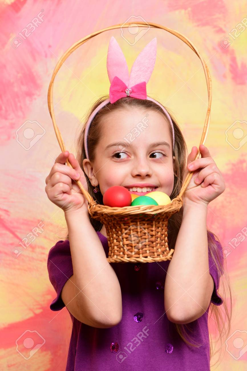 Small Baby Girl Or Cute Child With Happy Face Wearing Rabbit Stock