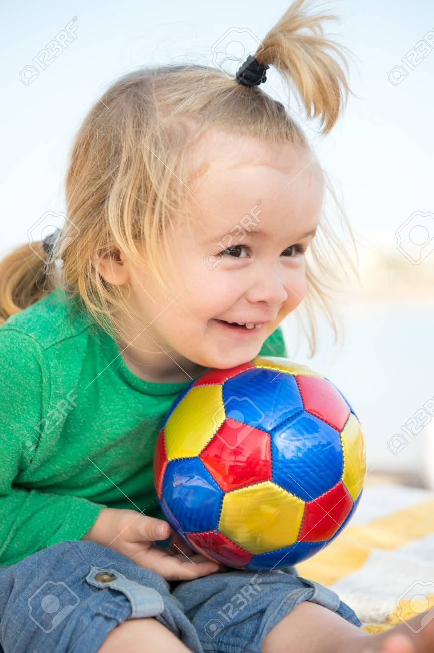 small baby boy or cute child with happy face and blonde hair.. stock
