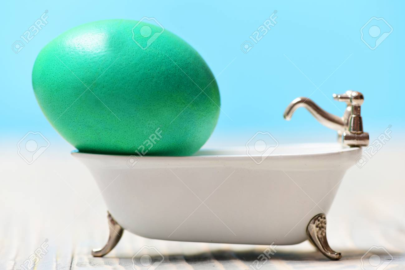 Healthy And Natural Food, Green Painted Egg In White Bath Tub ...