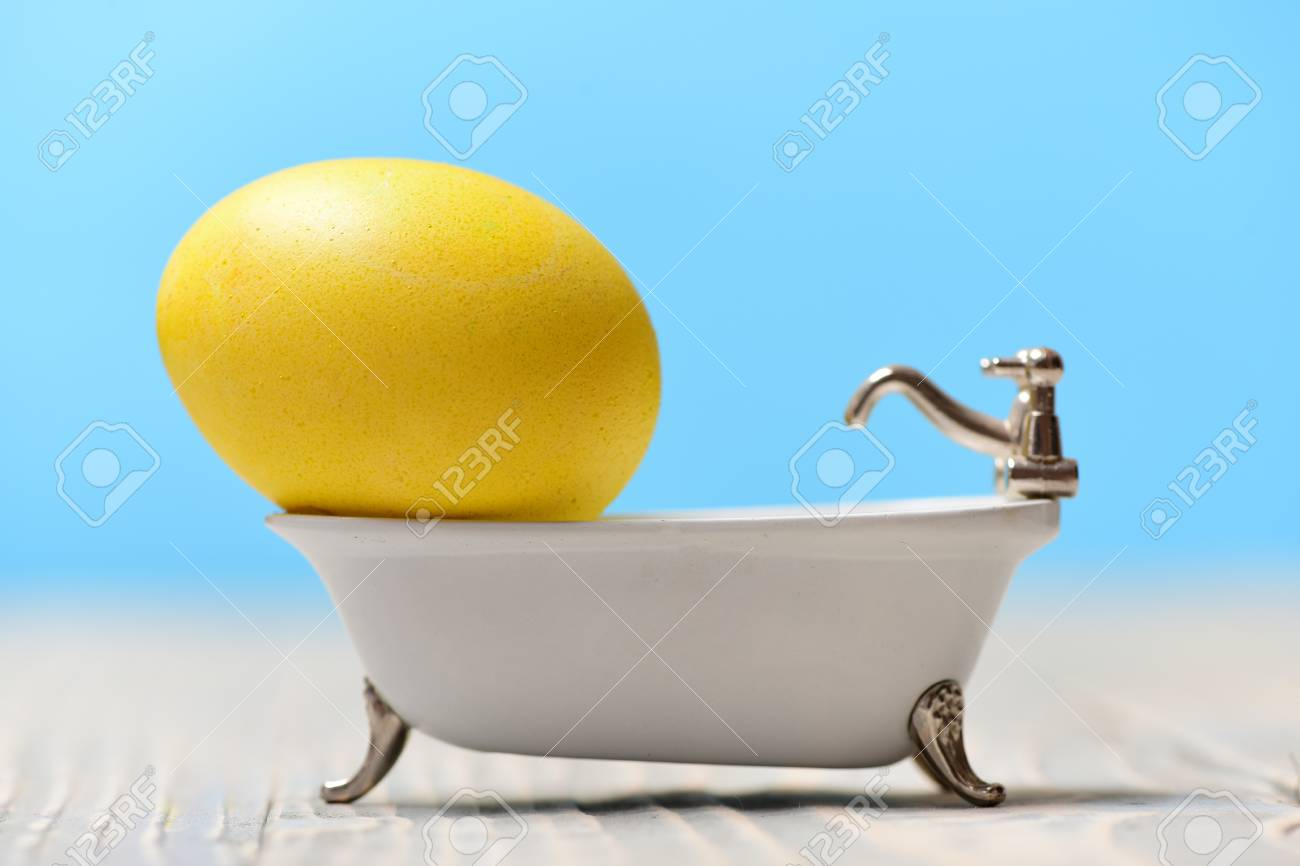 Spa And Future Life, Yellow Painted Egg In White Bath Tub In.. Stock ...