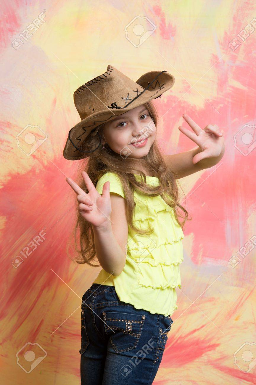 bef07517dbf31 cowgirl. happy child or little girl in cowboy hat with smiling cute face  and raised