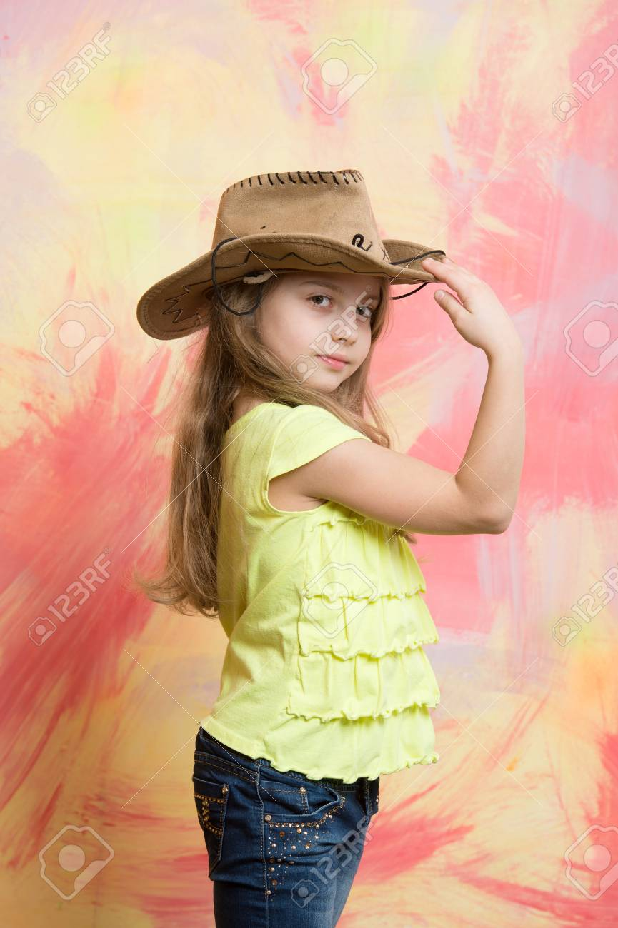 kid or baby girl in summer t shirt and cowboy hat on colorful abstract  background 7267045f87a4