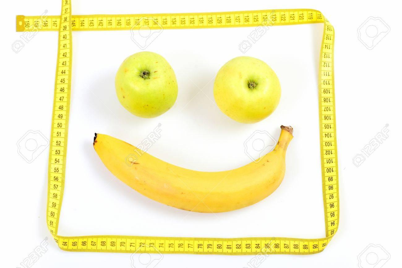 Banane Und Zwei Grüne Äpfel Macht Glückliches Gesicht Mit Maßband ...