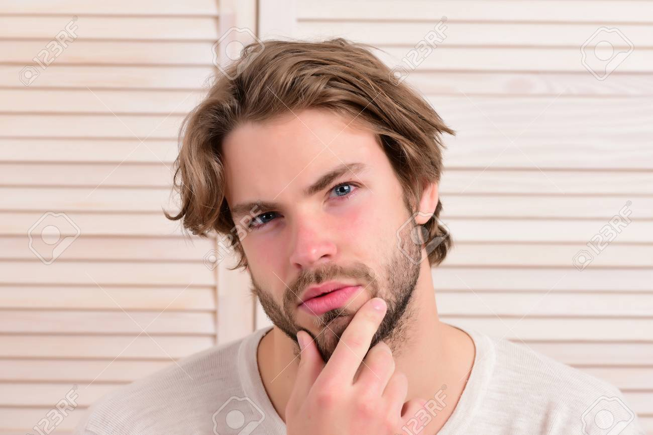 macho with fair beard and serious face guy with messy hair and