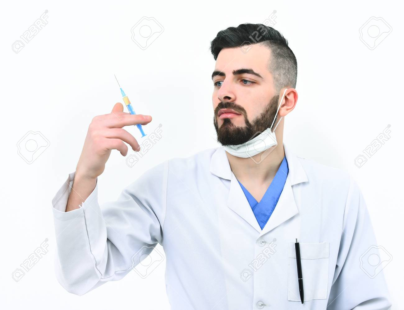 Man With Serious Face In White Hospital Gown And Surgical Mask ...