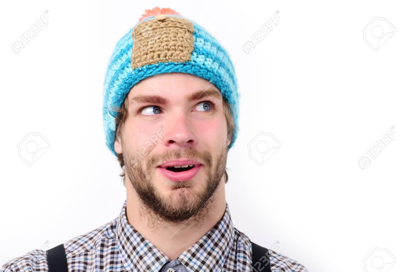Bearded man with surprised and happy face wears hat. Guy with hat in blue 307dd39aea0