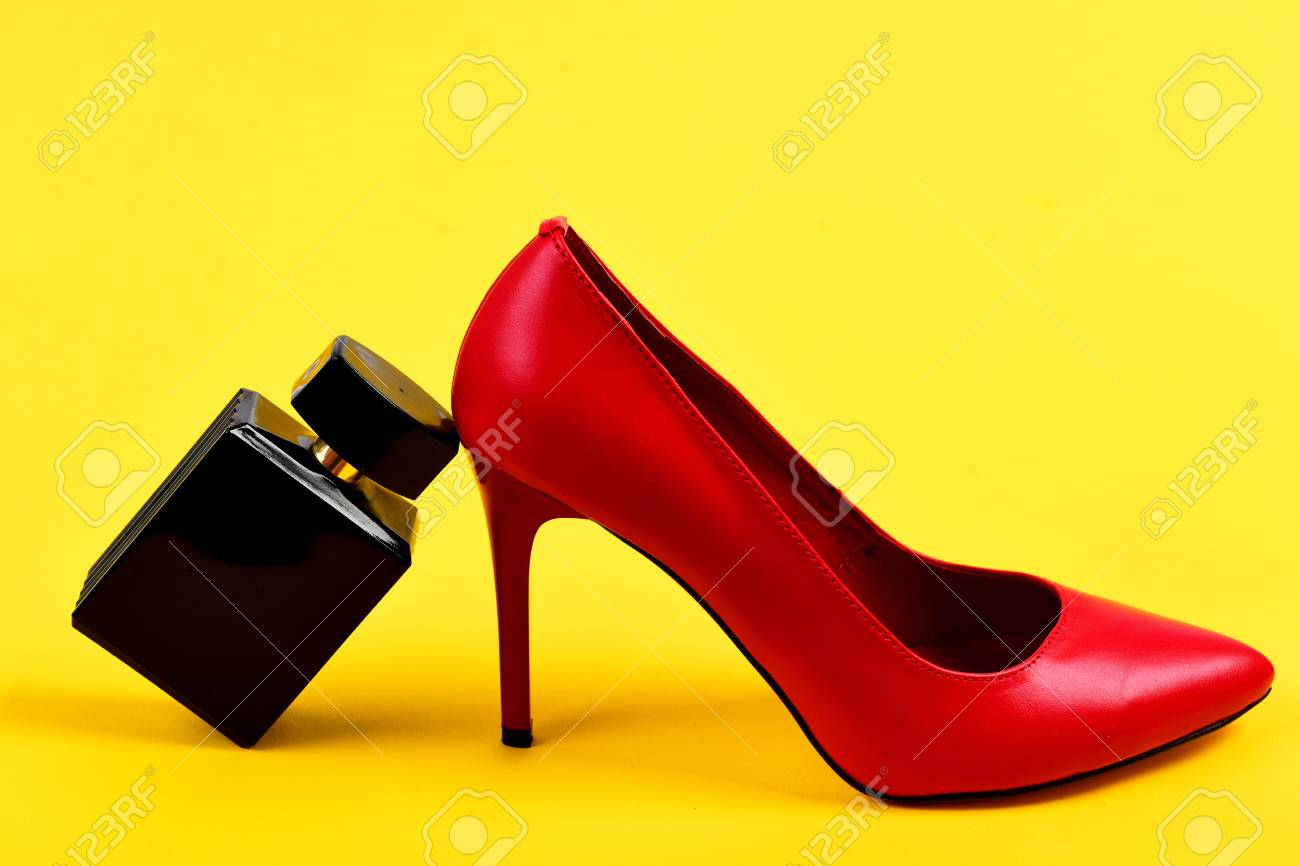 19b2ef07bbe Accessories on juicy yellow background. Female shoes in red color..