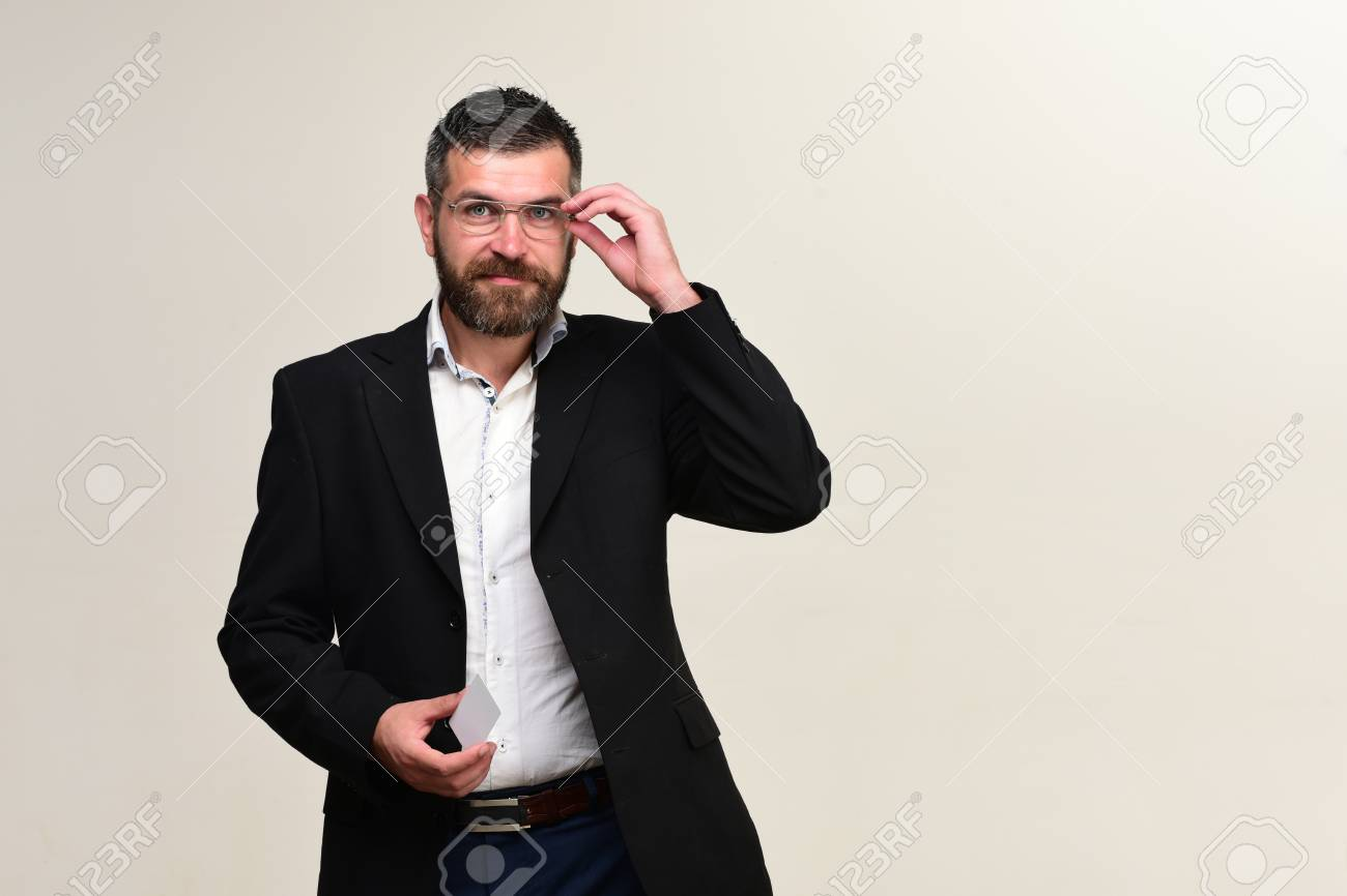 Businessman With Empty Card, Copy Space. Man In Suit With Beard ...
