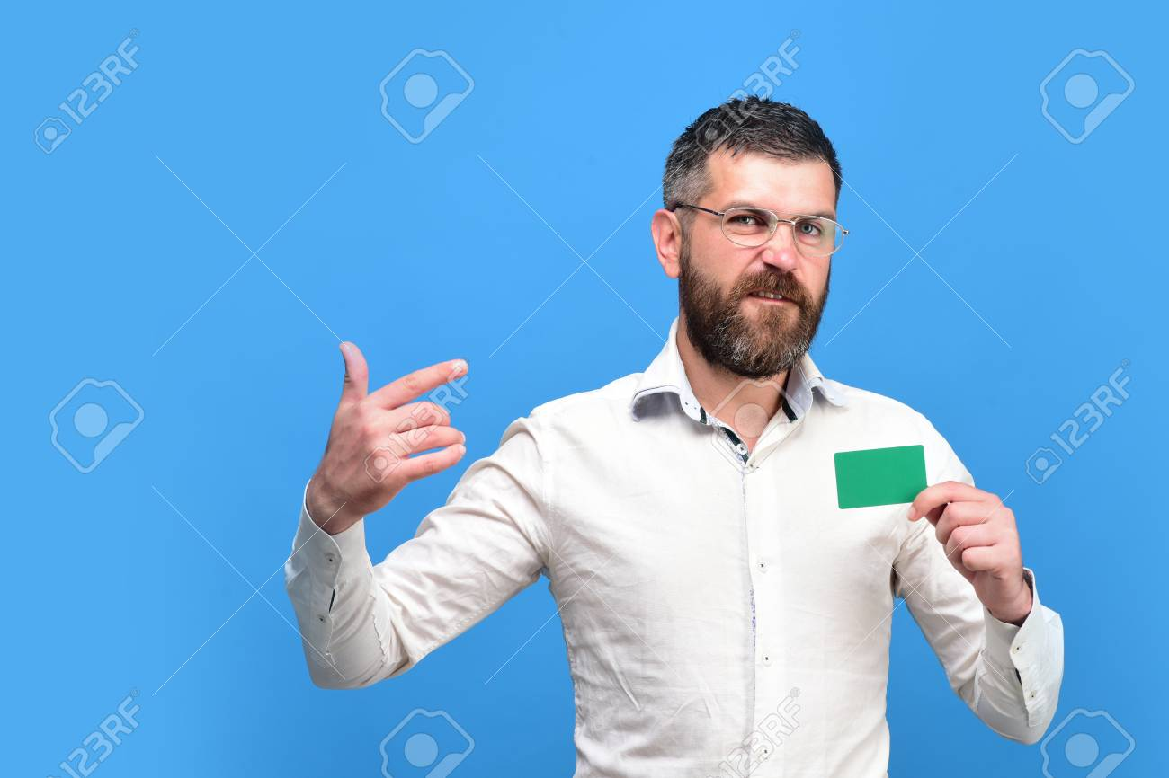 Man With Dark Beard In White Shirt Holds Blue Business Card... Stock ...