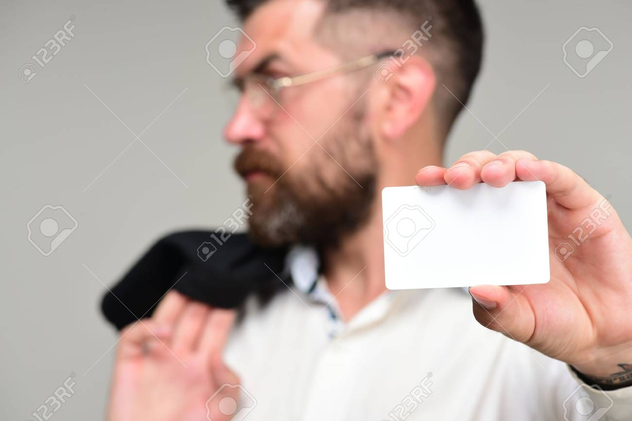 Man in suit with beard holds white business card guy with serious man in suit with beard holds white business card guy with serious face and glasses colourmoves
