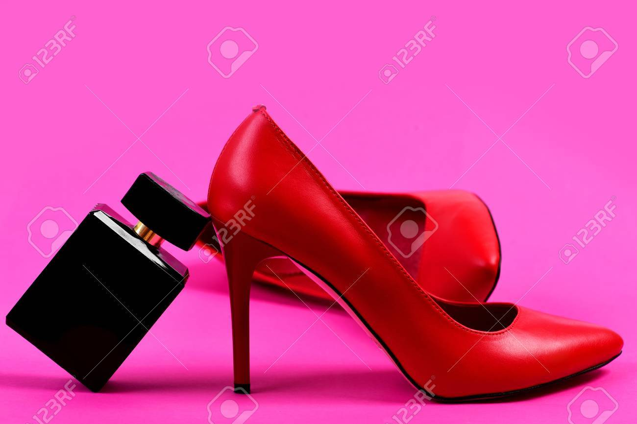 5ba7122eb204 Formal high heel footwear. Fashion and scent concept. Accessories on pink  background. Pair