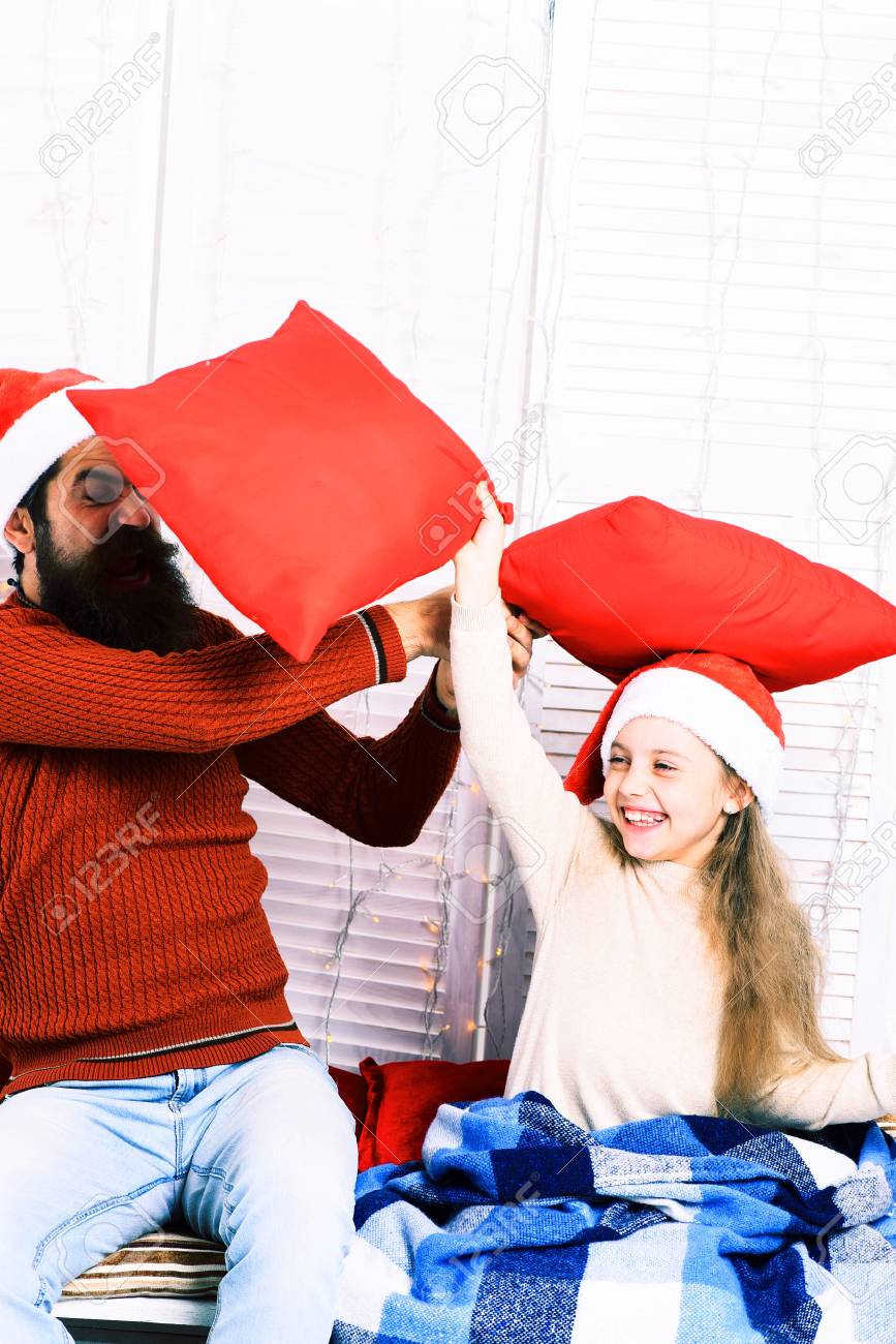 a75e01c035f handsome bearded funny man with long beard in christmas hat and cute blonde  smiling girl with
