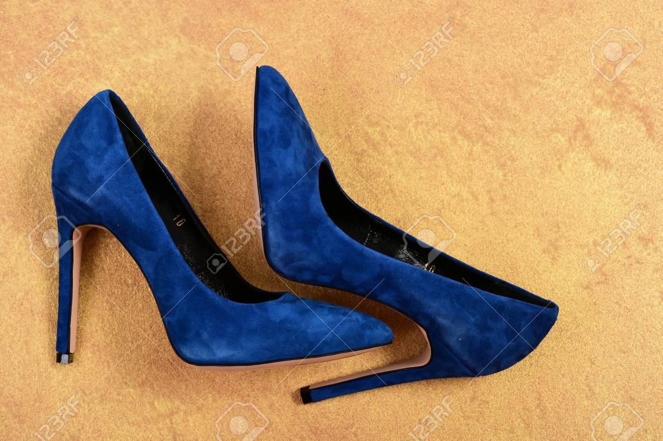 High Heel Shoes On Faded Orange
