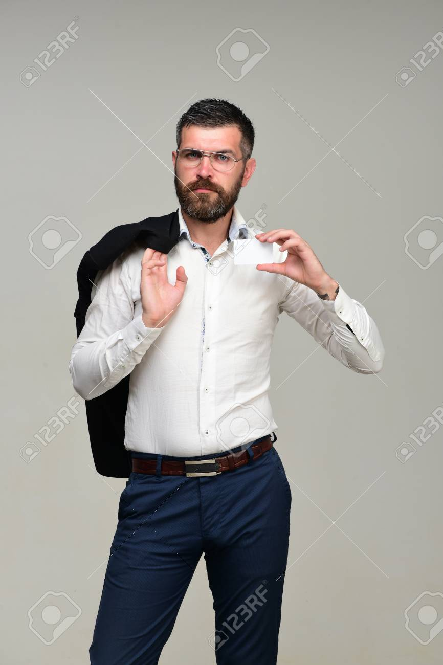 Guy with jacket on shoulder and business card copy space guy with jacket on shoulder and business card copy space businessman with serious face colourmoves