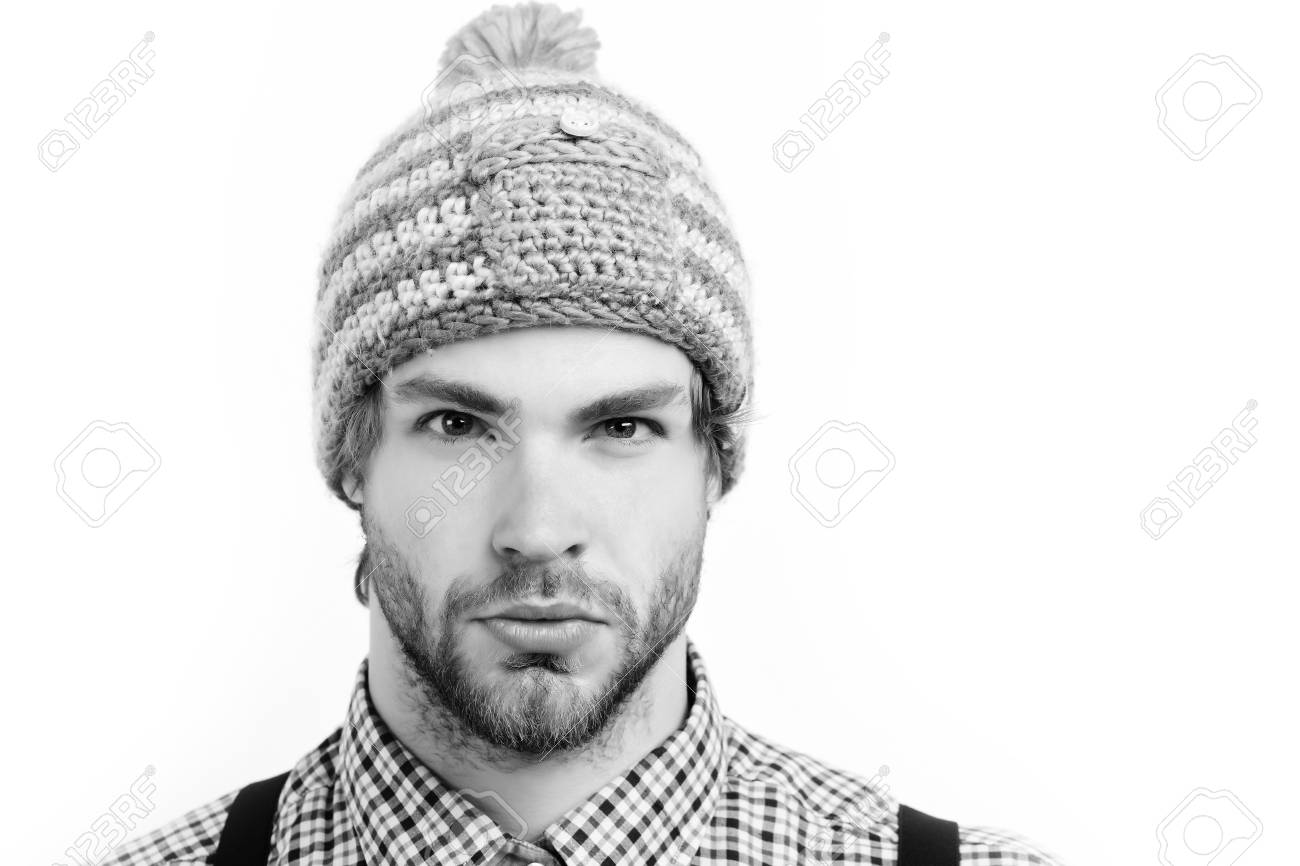 5f17302a528 Bearded man with confident face in hat. Man in winter hat and plaid shirt  isolated
