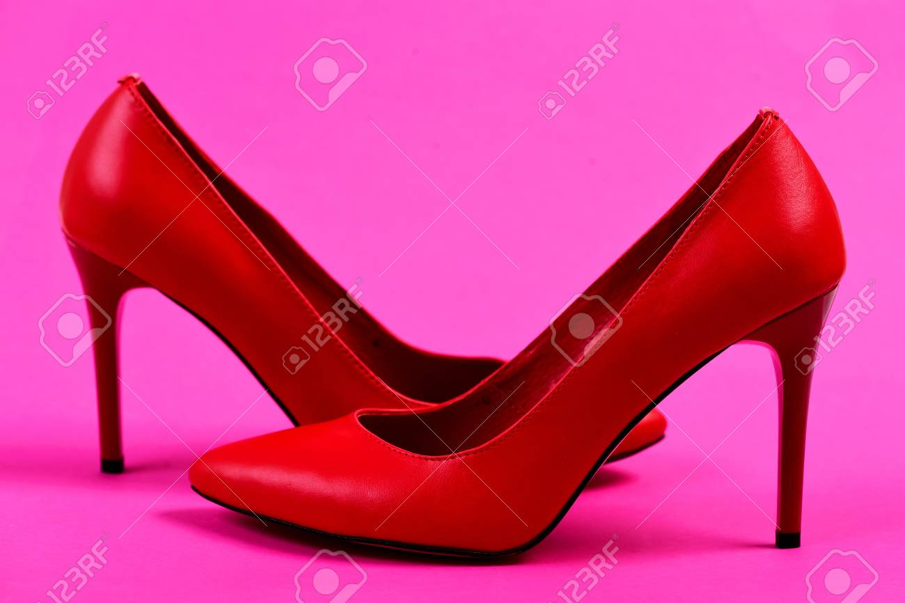 a3991975c96 Accessories on pink background. Formal high heel footwear. Female..