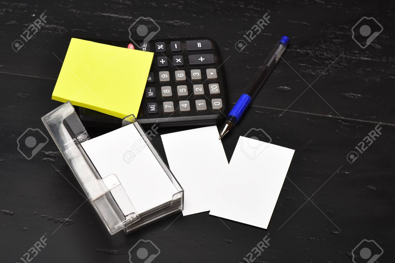Pen And Yellow Notes On Office Table. Business Card Holder With ...